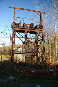 The skeletal remains of a mine shaft entrance.
