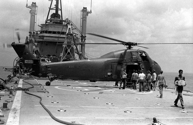The day was young and I decide to fly with the crew who take wounded and supplies to the USS Washo County, a support ship anchored in the Gulf of Tonkin. The ship looks like a gray speck surrounded by curving horizon as we chop in for a landing. I hop out, take my pictures and realize that after almost four years in the Navy this is the first and only time I set foot on a Navy ship at sea.