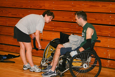 Karalyn Stoner and Eric Anderson.  Karalyn helping Erice get ready for a game.