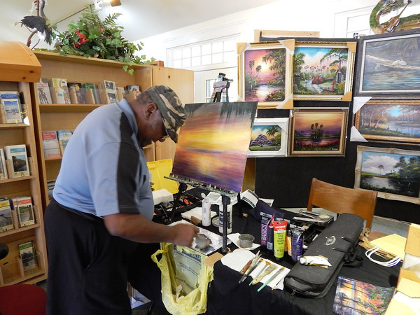 Visitors watched in awe as Florida Highwayman R.L. Lewis put paint to canvas.