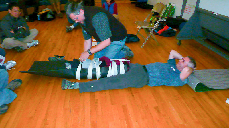 Thom relaxes while Sasha works on the splint.