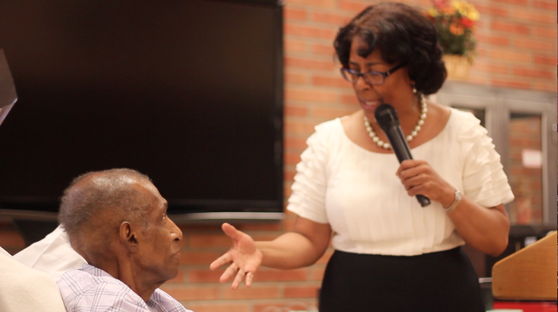 Willis listens intently to the comedic words of Councilwoman Jan Perry<br /> <br /> Photo by Isidra Person-Lynn