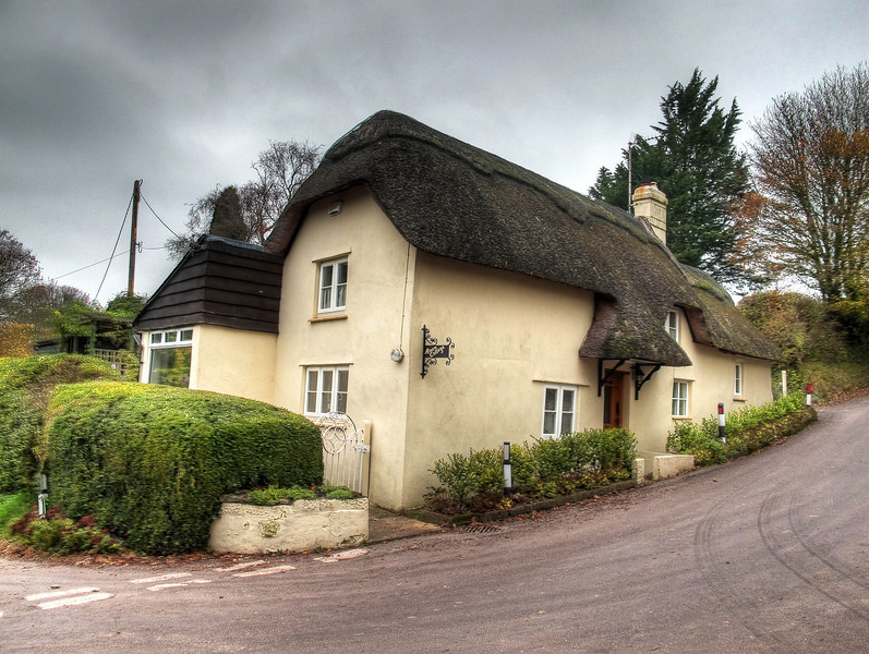 Amen Cottage standing on the crossroads at Amen Corner, Gussage All Saints.<br />  A chapel is said to have stood at this location.