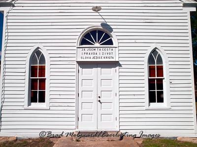 Entry doors with Czech script - Wesley Brethren Church-Brenham, Texas