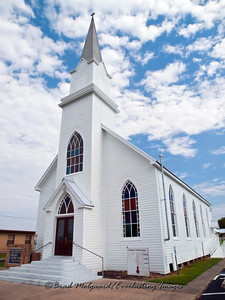 A grand white church with clouds - St. Michael's Lutheran Church, Missouri Synod - Winchester, Texas