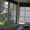 The windows on the upstairs room we call the office. We replaced these wood frame windows with aluminum frame sliders which leak a lot less.