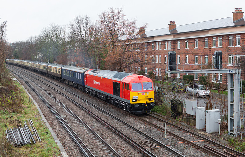 In stunning condition after its repaint in DB Schenker brand colours, 60092 throbs along the loop at New Kew junction with 1Z57 13.16 London Euston- Angerstein Wharf leg of the 1Z56 06.38 Crewe-Angerstein Wharf 'Thames Angerman' rail tour.22.12.12