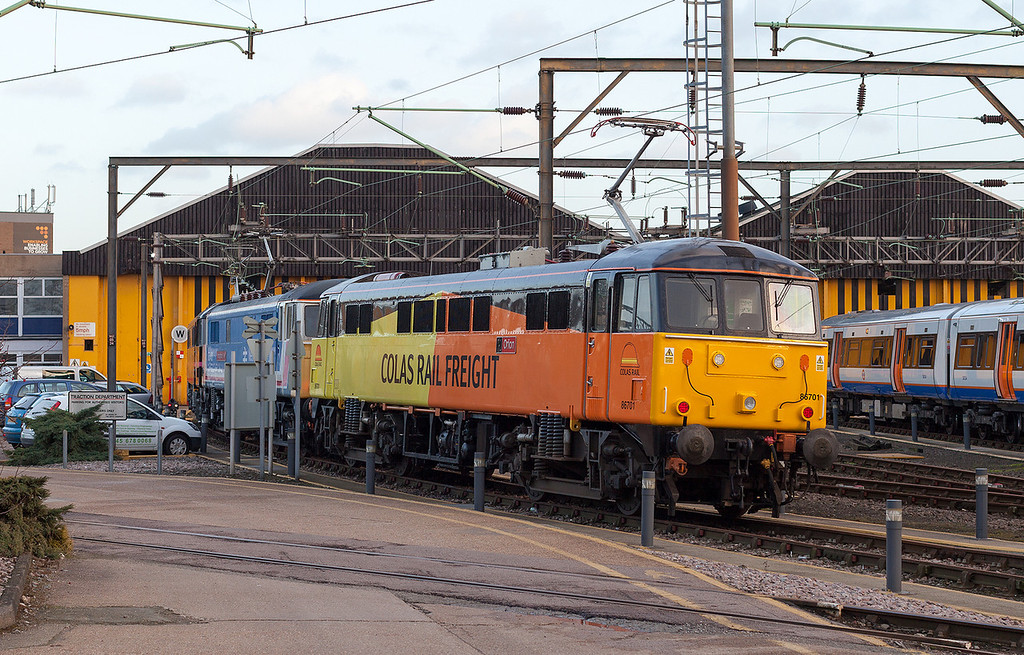 What will be the fate of 86701 in it's unique Colas Rail Freight livery? 86701 'Orion' sits next to 86401 in Willesden TMD on 31.1.13