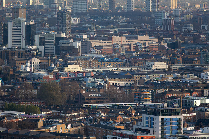 Taken with a powerful 300mm lens from the Strata building in Elephant and Castle we see two different Southern units approaching London Bridge. The telephoto lens has compressed the London Skyline and its hard to believe that the River Thames in situated behind the Butlers Wharf buildings.