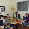 Playing Apples to Apples with nerf gun breaks.  Forest is holding his chocolate covered pretzels he got from the girls.
