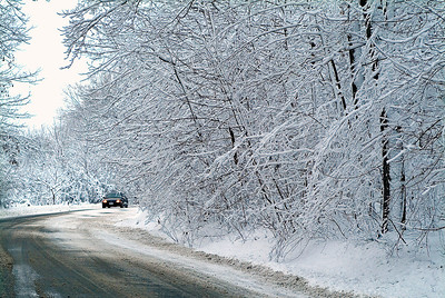 Car on Country Road in Winter