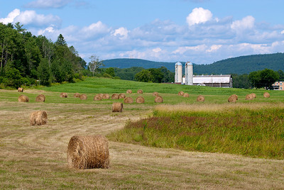 Round Hay Bales and Barn