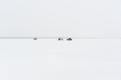 Ice fishing huts and truck