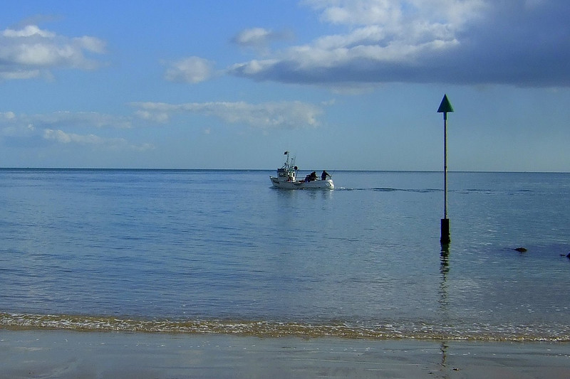 Fishermen chug past.