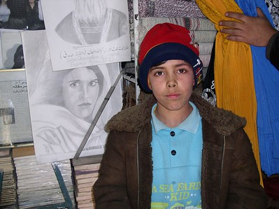 The best artist in Kabul. He is standing beside his latest work.