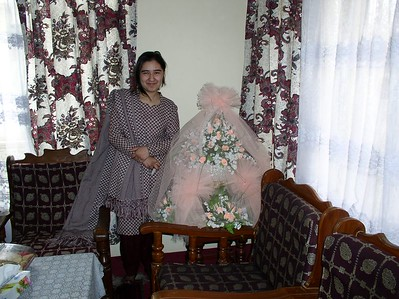 Sara (Pashtoon's daughter) with one of the engagement flower bouquets for her uncle. Engagement parties are big family occasions - traditional bonding of people.