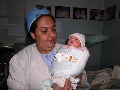 Nurse and a warm baby who was quickly assessed and wrapped Afghan-style.