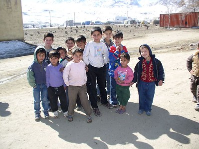 The first group of kids to receive shoes. They were waiting patiently. Notice the snow covered hills behind them. The field directly behind is a graveyard. Over half these kids rely on 1 parent for support.