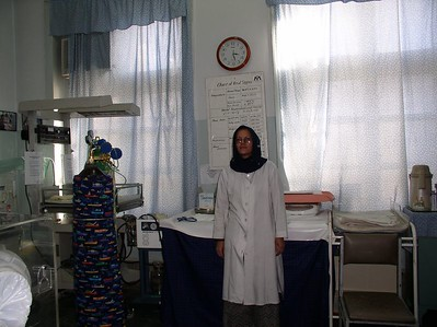 Dr. Johan, top pediatrician posing in front of the stabilization zone in the nursery.