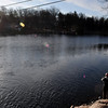 Dana Gustafson, 52, of Centuria, Wis., fishes beneath power lines snagged with lures on Balsam Lake. (Pioneer Press: Dave Orrick)