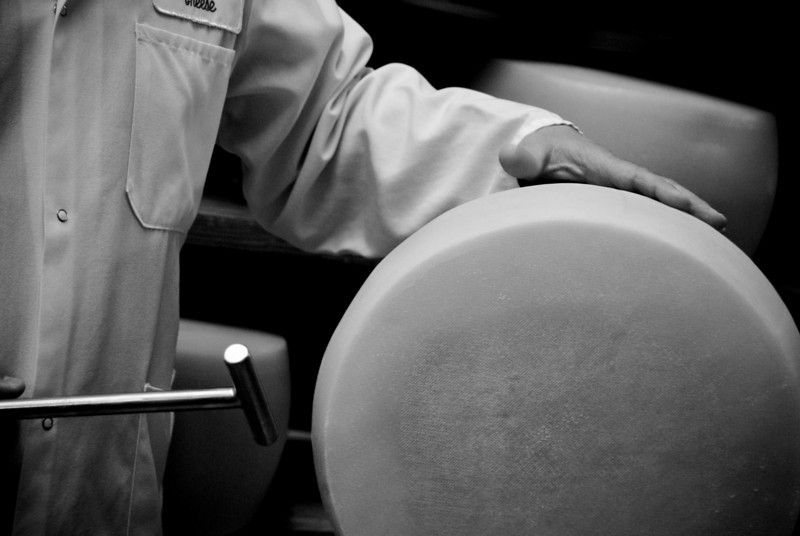 Master cheesemakers can divine how well a cheese is aging simply by<br /> tapping it with a hammer. Pictured is Gianni Toffolon of BelGioioso.