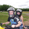 Alex and Hayley take turns driving and riding Kathy's machine.