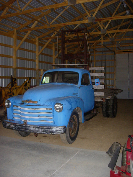 Vintage 1951 Chevy truck tricked out to work as a log skidder.