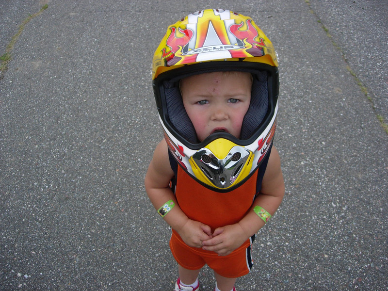 Refusing to be left behind, Little Alex dons his helmet and is ready to go.