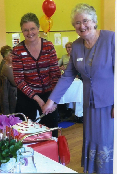 Cutting the Anniversary cake - Anne Barker & Joyce Clayton