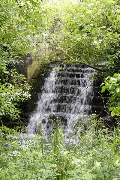 A waterfall at the castle base.