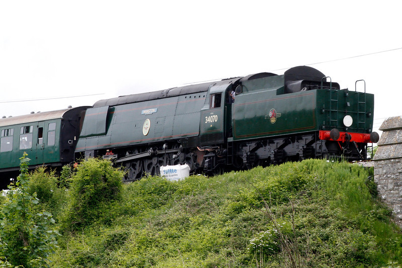 """Swanage Railways' beautifully restored Battle of Britain class """"Manston""""<br /> steam locomotive leaves Norden passing Corfe Castle bound for Swanage.<br /> See <a href=""""http://www.swanagerailway.co.uk/news459a.htm"""">http://www.swanagerailway.co.uk/news459a.htm</a> for more about the restoration."""