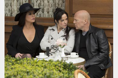 """. Catherine Zeta-Jones (left) joins Helen Mirren, Mary-Louise Parker (right) and a lot of old guys to shoot guns in \""""RED 2,\"""" in theaters July 19."""