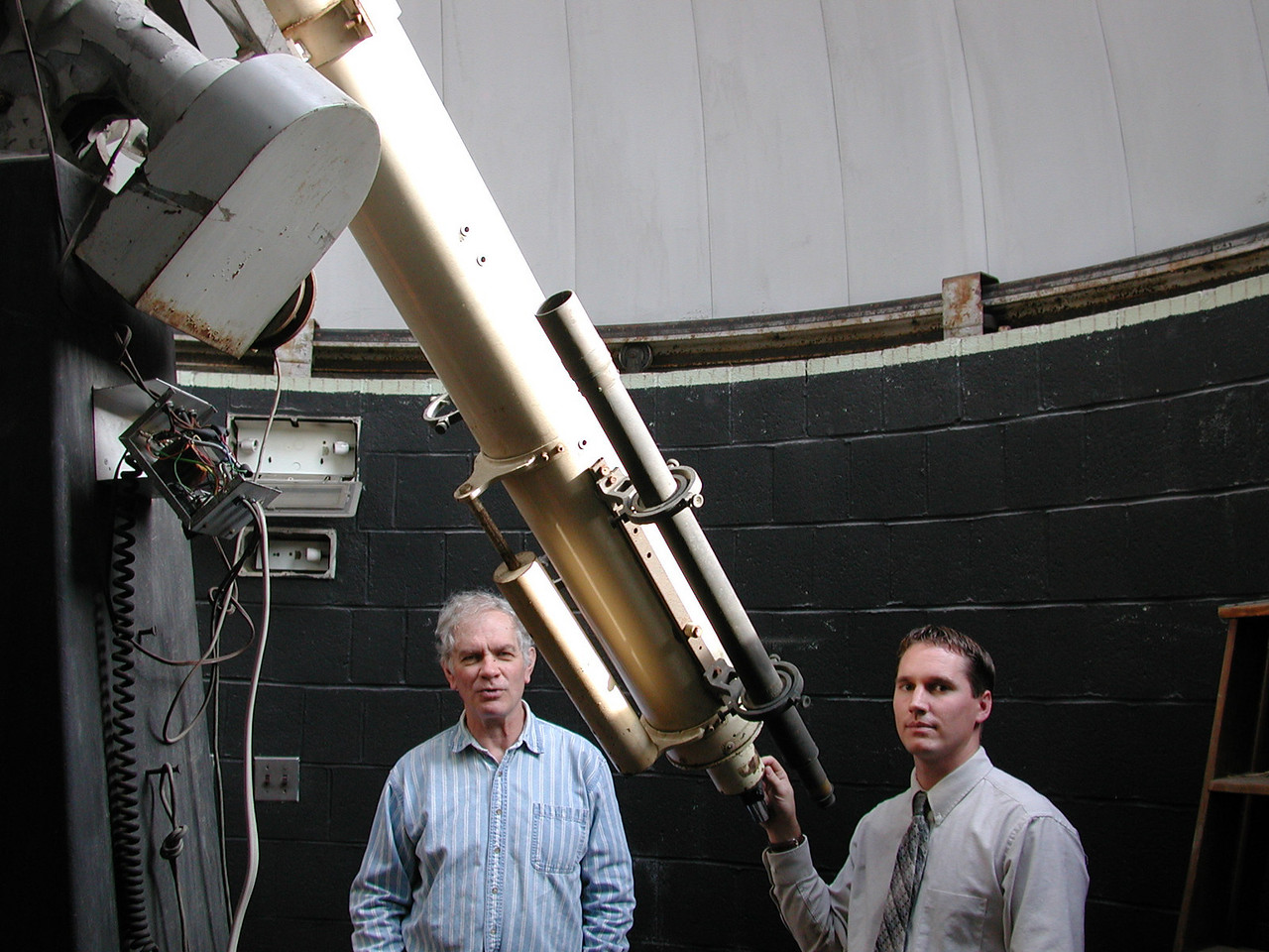 The telescope moves freely about both RA and Decl. axises and is quite comfortable to move by hand. The telescope tube also tapers from larger (at the main lens) to smaller at the observers end. This of course is the design used in older refractors and helps off set the balence of the scope at the tail end for finders and other accessories. (Dave Smith and Jayson Kowinsky pictured.)