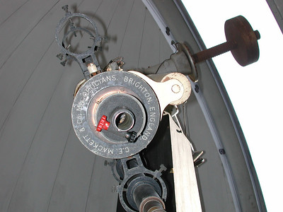 Telescope from the observers end reveals the instruments maker.