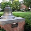 The Paul Revere Bell, on display. Our building and windows in the background. Our windows are the gables on the top floor.  Being under the roof gave the room interesting architectural features.