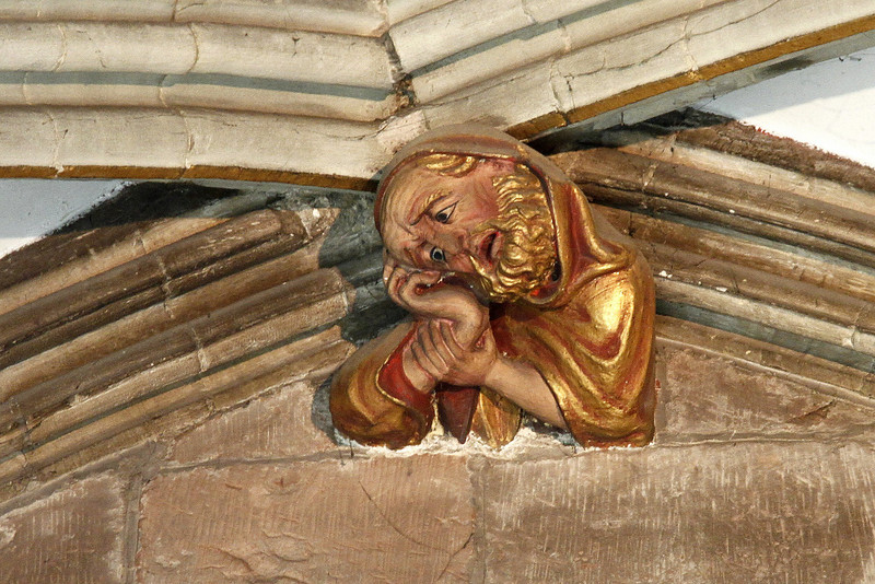 I was told that this is thought to be a representation of the architect - he certainly looks stressed enough!