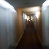 Walking down the hotel hallway.