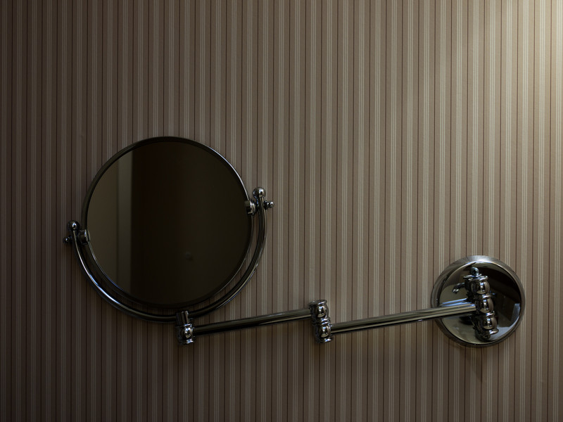 The hotel room shaving mirror.