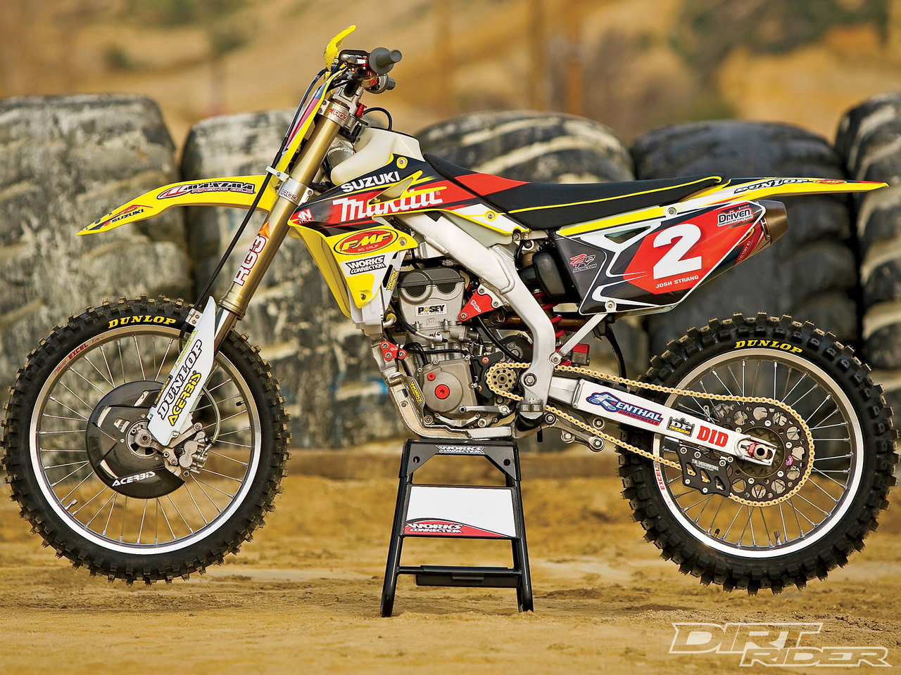 141_1006_01_z 2010_factory_off_road_race_bikes FMF_bike_side_view