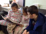 5C enjoy sharing a book with their buddy class 1PC