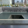 North memorial pool. Base of Freedom tower left background. Memorial pools are footprints of original towers.