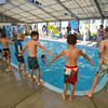 The children participating in the World's Largest Swim Lesson line up around the pool to begin the lesson at the Broomfield Academy on Thursday.<br /> <br /> June 14, 2012 <br /> staff photo/ David R. Jennings