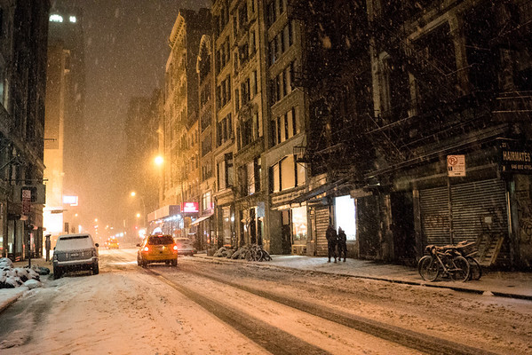 <h2>New York Winter Night - Snow on a City Street</h2> - By Vivienne Gucwa  On a winter night in New York City, snow falls onto the street and fire escapes as a couple walks along icy sidewalks during a beautiful winter storm. This was taken during winter storm Nemo as the snow blanketed Manhattan.  ---
