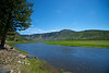 The Yellowstone River flows forward through the nation's first national park.