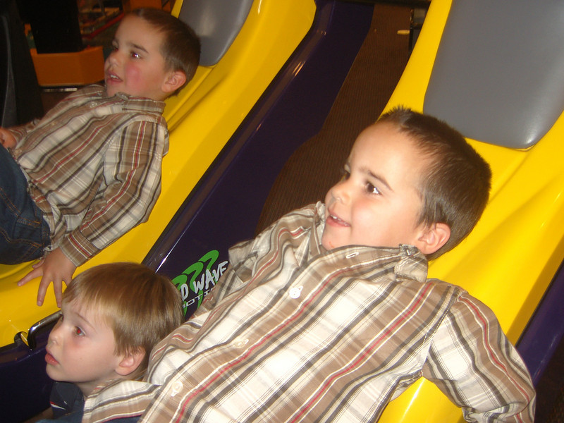 The birthday boys and Zackie...on a fun video ride at the Pizza Joint (I forgot the name of it)