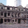 Deteriorated old buildings in Shanghai with high rises behind