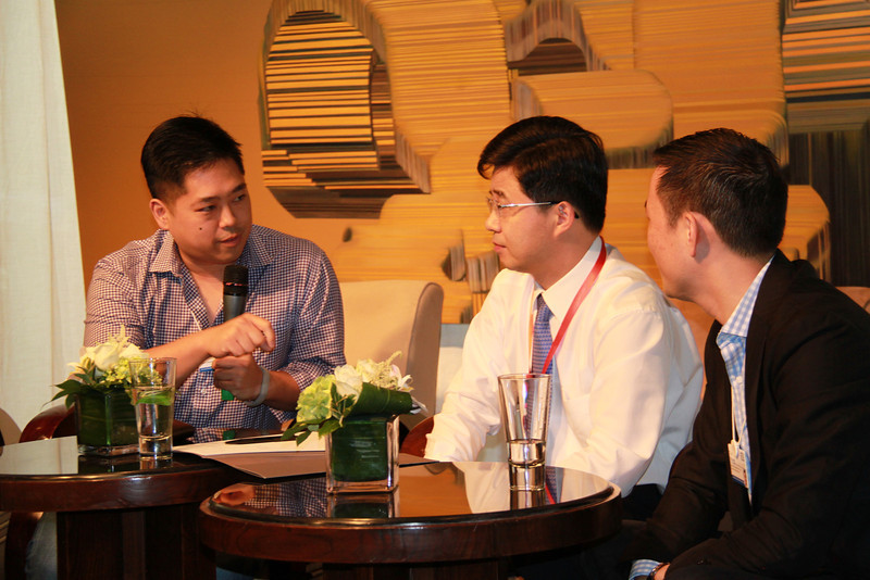 Host Jacob Hsu (YGL) speakS with Vice-Mayor of Changzhou, with Tim Wang translating