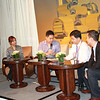 Hosts Peggy Liu and Jacob Hsu speak with Vice-Mayor of Changzhou, with Tim Wang translating