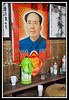 Shrine to Mao just inside the front door of house...