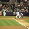 Derek Jeter looking at a strike.